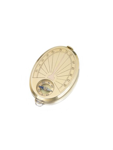 CARTIER | A YELLOW GOLD OVAL FORM OPEN FACED WATCH WITH COMPASS CIRCA 1935