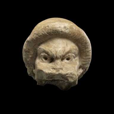 View 1. Thumbnail of Lot 104. A Fragmentary Roman Marble Theater Mask, circa 2nd Century A.D..
