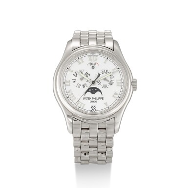 PATEK PHILIPPE  |  REFERENCE 5036,  A WHITE GOLD ANNUAL CALENDAR BRACELET WATCH WITH MOON PHASES AND POWER RESERVE INDICATION, CIRCA 1998