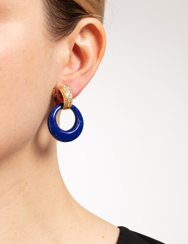 View 6. Thumbnail of Lot 131. Paire de clips d'oreille lapis-lazuli, onyx et diamants | Pair of lapis lazuli, onyx and diamond ear clips.