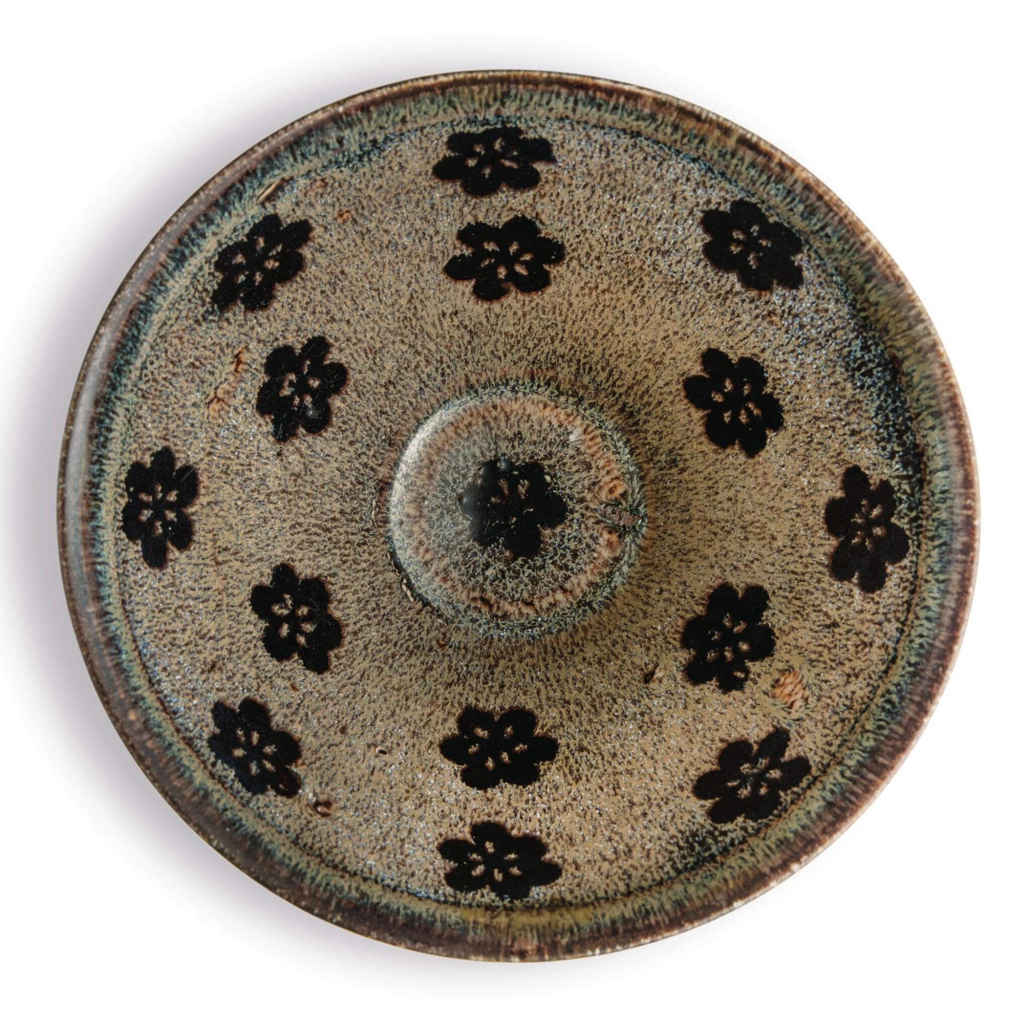 View full screen - View 1 of Lot 102. A 'Jizhou' 'papercut' bowl, Southern Song dynasty | 南宋 吉州窰剪紙貼花梅花紋盌.
