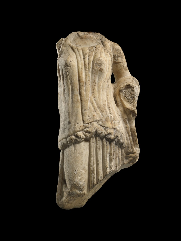 A GREEK MARBLE TORSO OF A GODDESS, 1ST HALF OF THE 4TH CENTURY B.C.