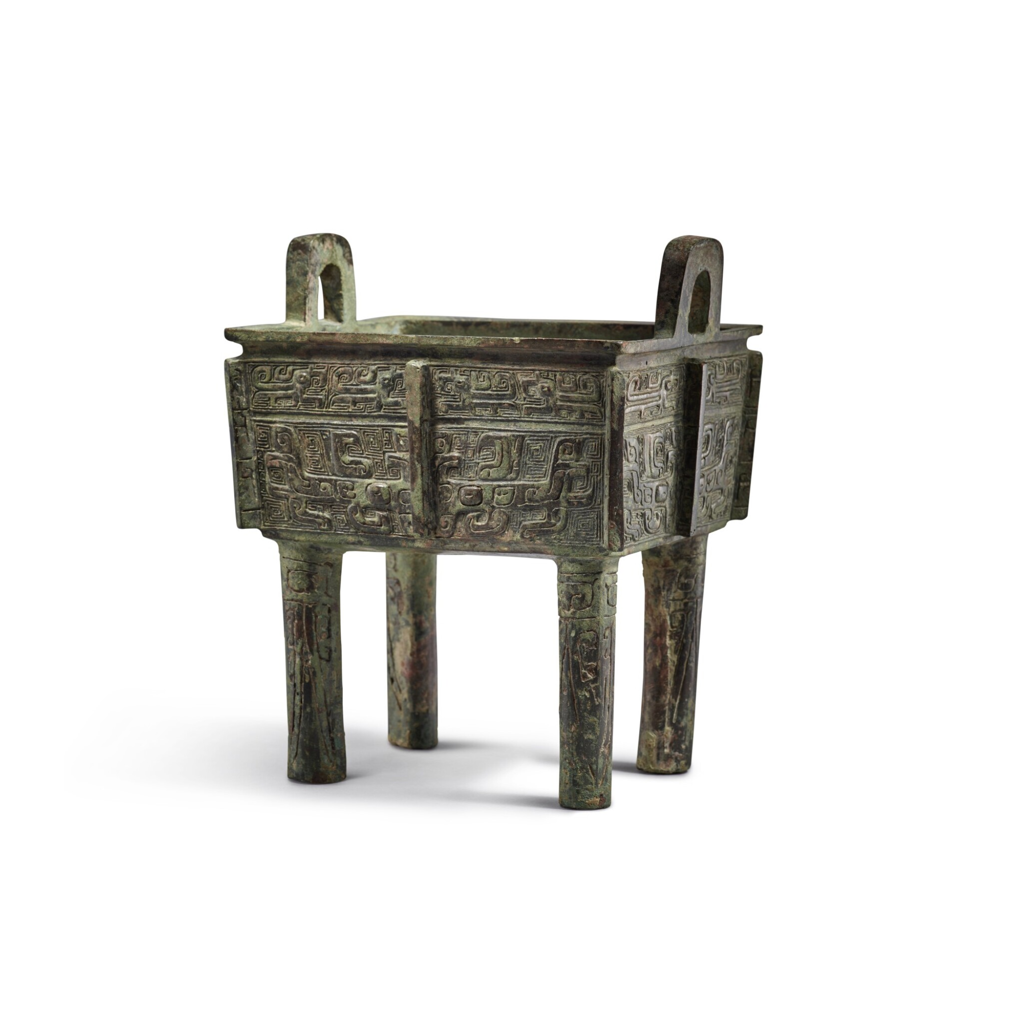 View full screen - View 1 of Lot 10. An archaic bronze food vessel (Fangding), Early Western Zhou dynasty | 西周初 青銅饕餮紋方鼎.