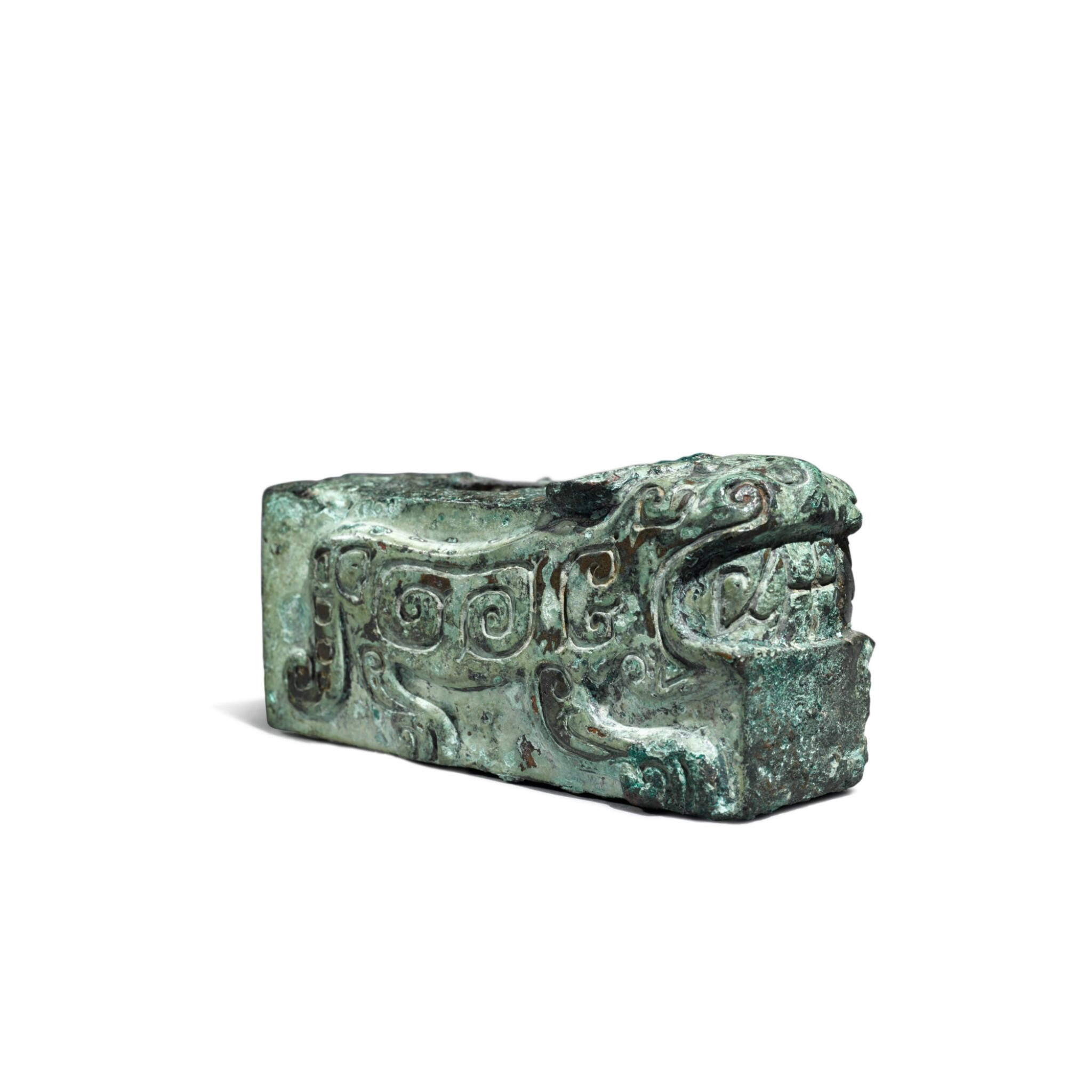 View full screen - View 1 of Lot 24. An archaic bronze 'tiger' fitting, Shang dynasty | 商 青銅虎紋部件.