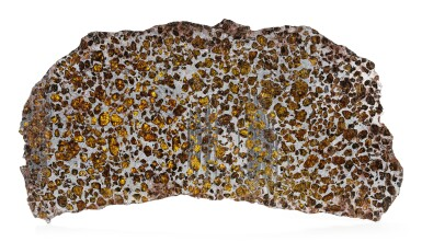 A LARGE SLICE OF THE FUKANG PALLASITE METEORITE