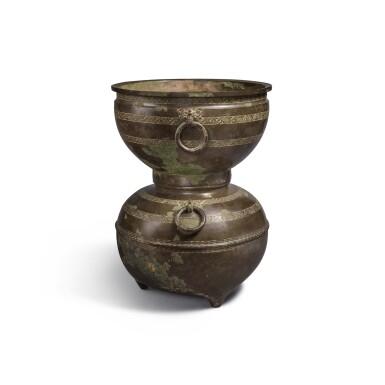 View 3. Thumbnail of Lot 20. An archaic bronze ritual food steamer (Yan), Eastern Zhou dynasty, early Warring States period   東周 戰國初 青銅交龍紋鋪首耳甗.