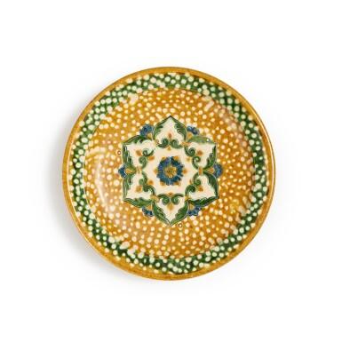 View 1. Thumbnail of Lot 173. A sancai and blue-glazed pottery tripod dish, Tang dynasty | 唐 三彩加藍寶相花紋三足盤.