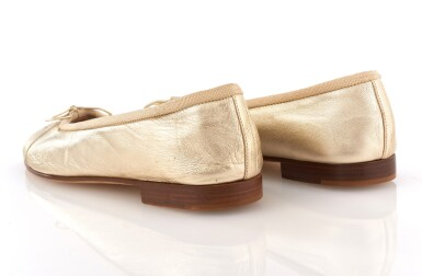 View 2. Thumbnail of Lot 58. Pair of gold leather flats.