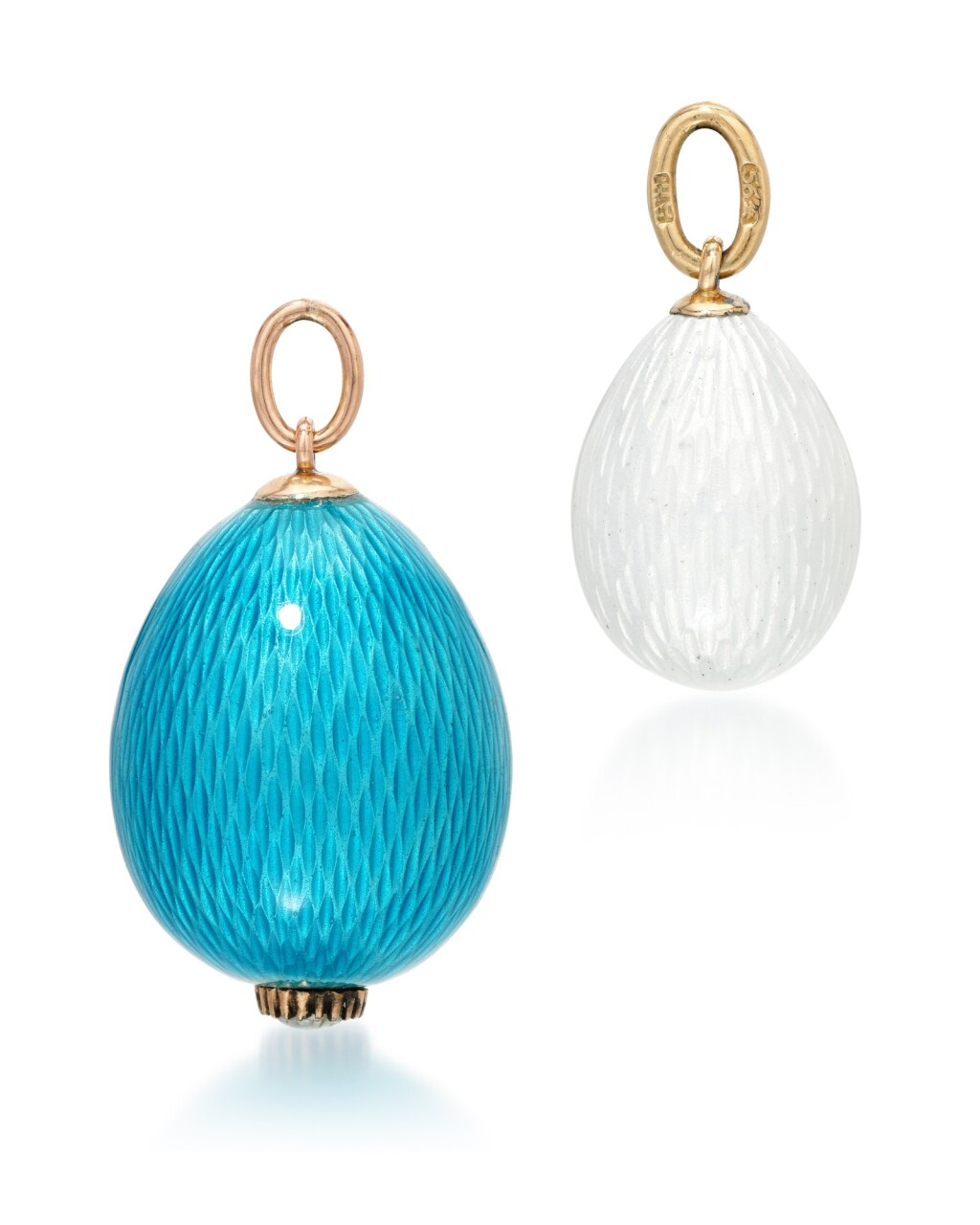 TWO GUILLOCHÉ ENAMELLED EGG PENDANTS, THE WHITE EGG BY FABERGÉ, WORKMASTER AUGUST HOLMSTRÖM, ST PETERSBURG, CIRCA 1890