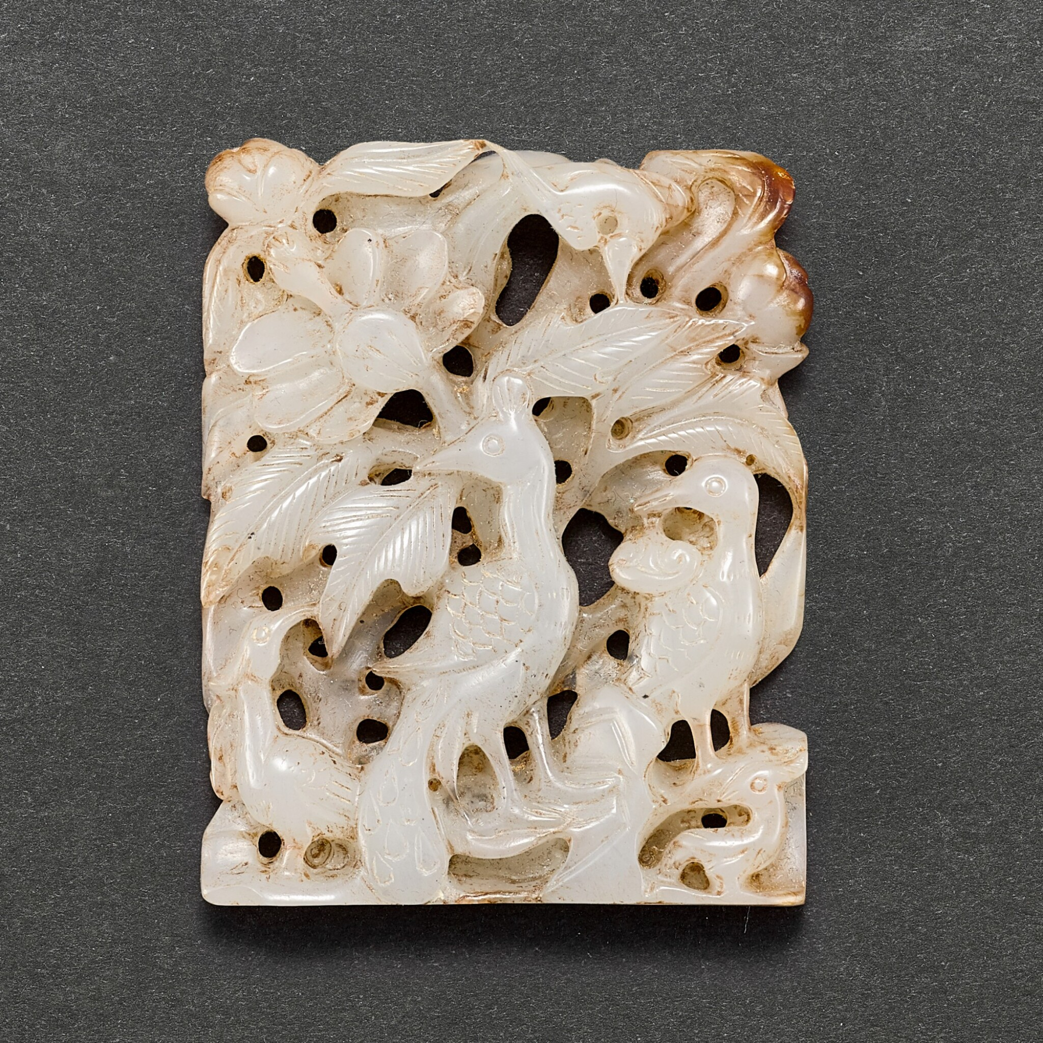 A GREYISH JADE RETICULATED 'PEACOCK' PLAQUE LIAO - JIN DYNASTY | 遼至金 灰白玉鏤雕孔雀花卉珮飾