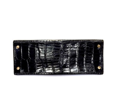 View 6. Thumbnail of Lot 743. HERMÈS | BLACK KELLY 28 IN SHINY CROCODILE WITH GOLD HARDWARE, 1962.