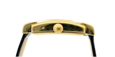 View 4. Thumbnail of Lot 302. REFERENCE 2443 A YELLOW GOLD RECTANGULAR WRISTWATCH, CIRCA 1950.