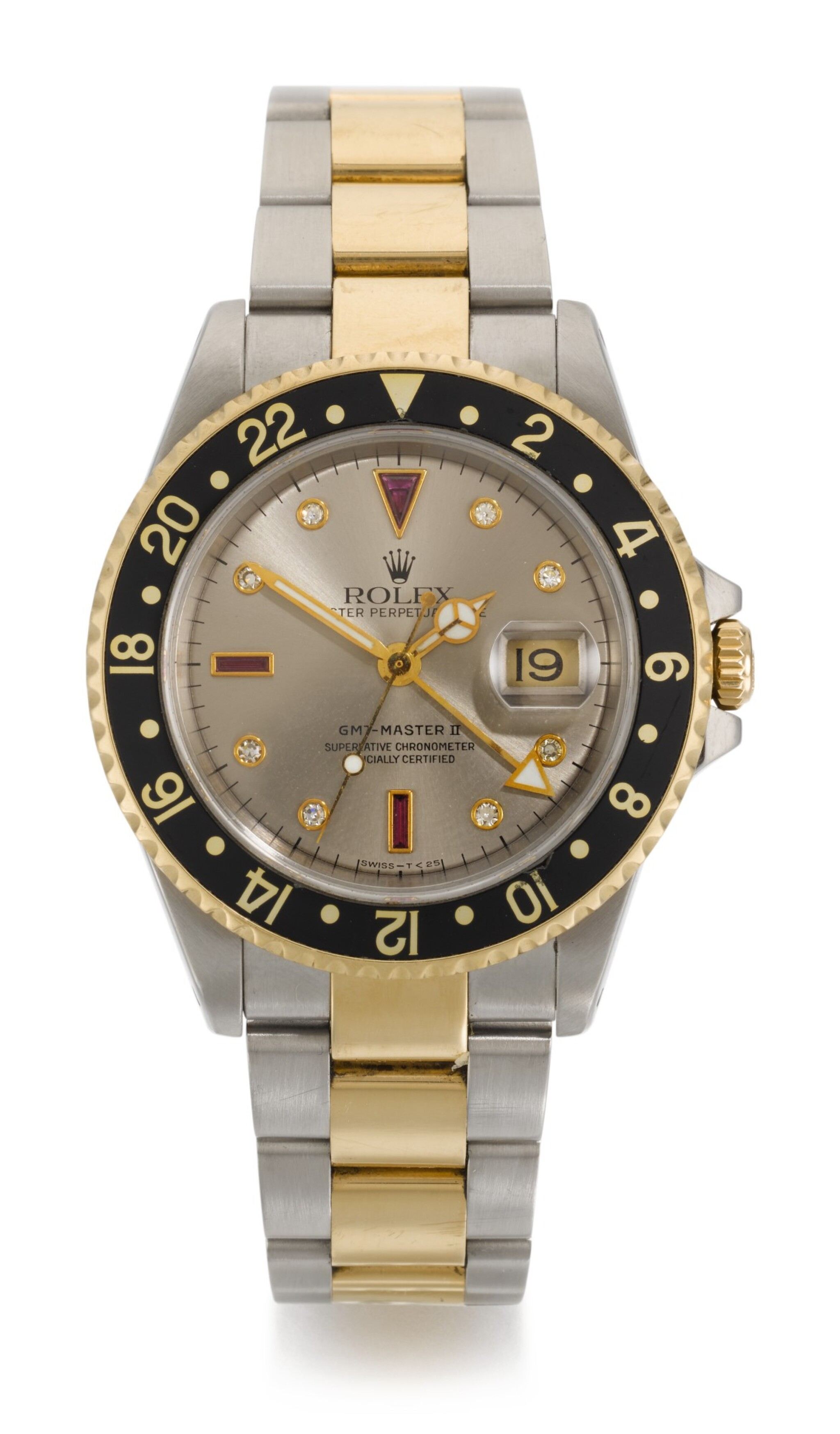 ROLEX | GMT-MASTER II SULTAN, REFERENCE 16713, STAINLESS STEEL AND YELLOW GOLD DIAMOND AND RUBY-SET DUAL-TIME WRISTWATCH WITH DATE AND BRACELET, CIRCA 1998