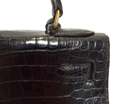 View 11. Thumbnail of Lot 743. HERMÈS | BLACK KELLY 28 IN SHINY CROCODILE WITH GOLD HARDWARE, 1962.