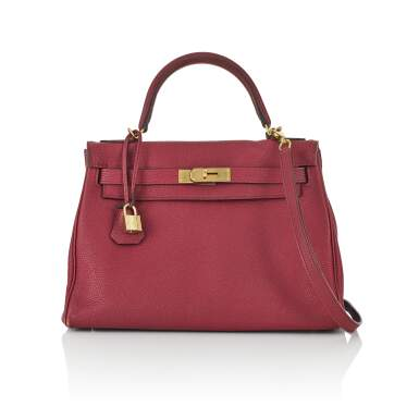 View 1. Thumbnail of Lot 2. HERMÈS | ROUGE COLOUR KELLY RETOURNÉ 28 IN TOGO LEATHER  WITH GOLD HARDWARE, 2017.