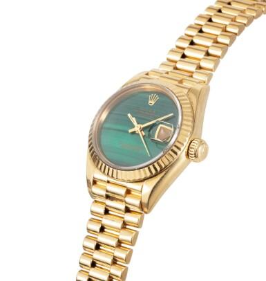 View 2. Thumbnail of Lot 77. Rolex | Montre bracelet de dame or et malachite | Gold and malachite lady's bracelet watch.