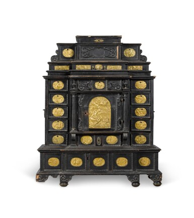 View 1. Thumbnail of Lot 86. A South German gilt-metal mounted, ebonised and carved table cabinet, possibly Augsburg, early 17th century.