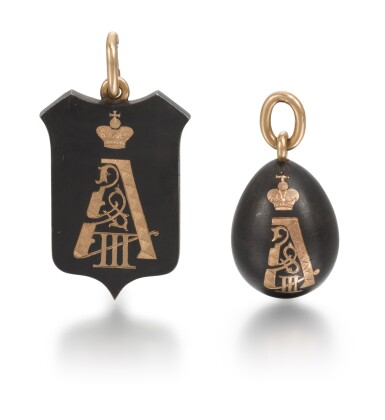 View 1. Thumbnail of Lot 2. Two Imperial Fabergé gold and gunmetal pendants, the shield pendant, workmaster Michael Perchin, St Petersburg, circa 1894.