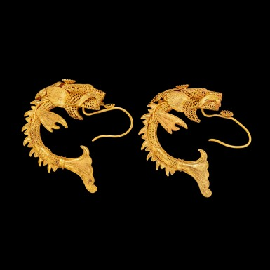 View 1. Thumbnail of Lot 1017. A pair of Chinese gold filigree 'Makara' earrings Qing dynasty 清 金纍絲魚化龍耳環一對.