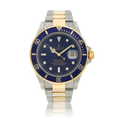 View 1. Thumbnail of Lot 10. Reference 16613 Submariner  A yellow gold and stainless steel wristwatch with date and bracelet, Circa 2002 .
