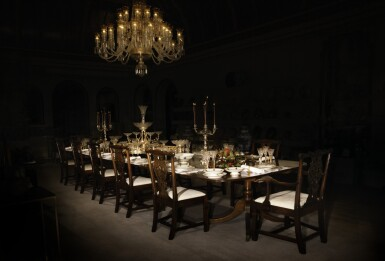 The Emperor's Table | A magnificent 18th century George III dining table with 12 Chippendale style carved chairs, a 36 branch St Louis crystal chandelier and an elegant Sevres dinner service made for Emperor Napoleon I, silver candelabra by Odiot, a service of antique cutlery and an impressive mirror and silver-plate plateau centrepiece