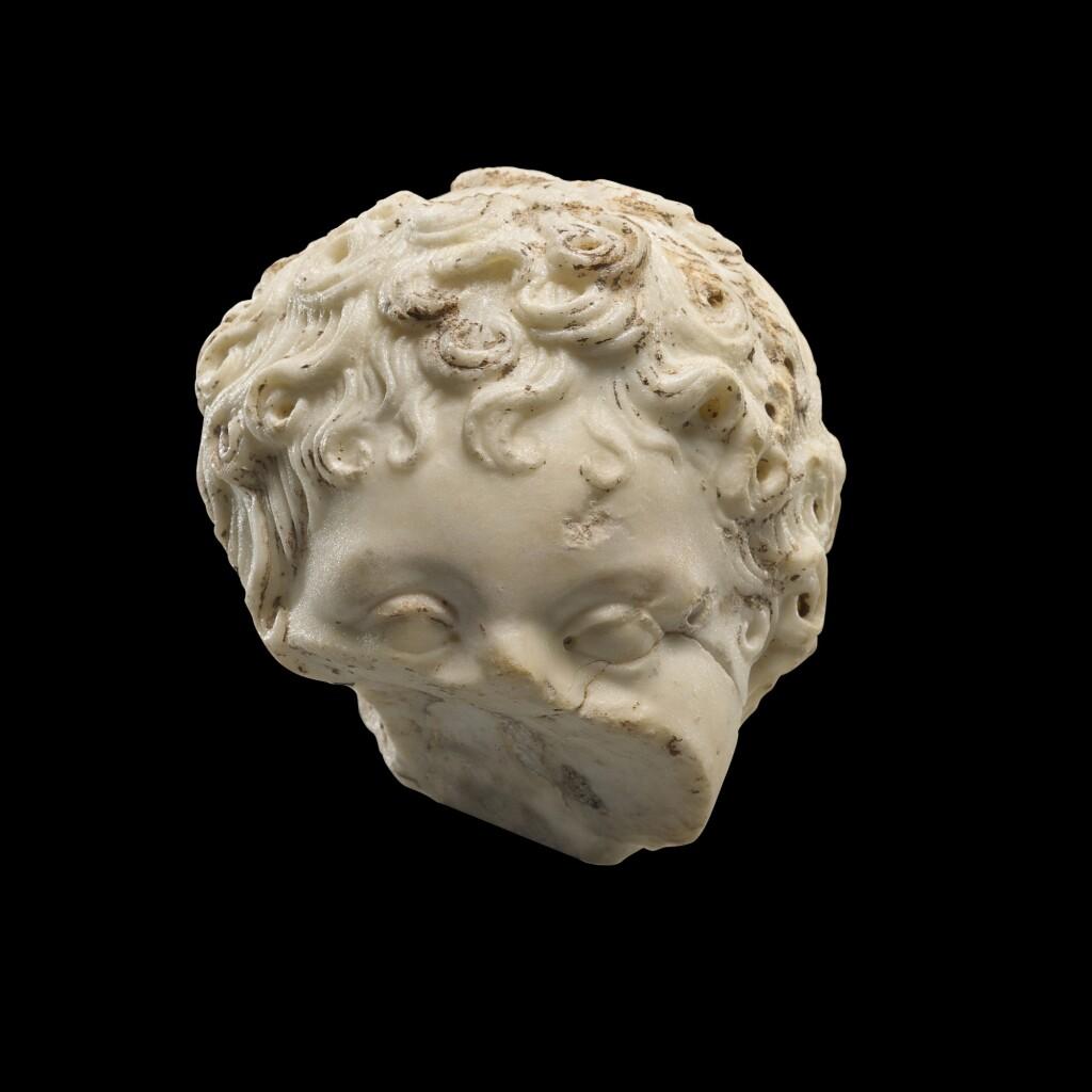 A FRAGMENTARY ROMAN MARBLE PORTRAIT HEAD OF A BOY, CIRCA MID 1ST CENTURY A.D.