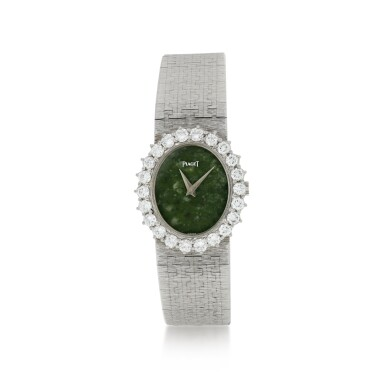 View 1. Thumbnail of Lot 63. PIAGET   REFERENCE 9338 A 6  A WHITE GOLD AND DIAMOND-SET BRACELET WATCH WITH JADE DIAL, CIRCA 1985.