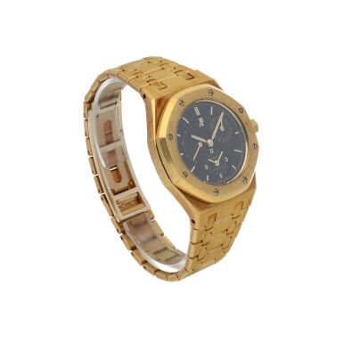 View 3. Thumbnail of Lot 32. Royal Oak, Ref. 25730BA/O/0789BA/01  Yellow gold dual time wristwatch with date, power reserve indication and bracelet  Circa 1998.
