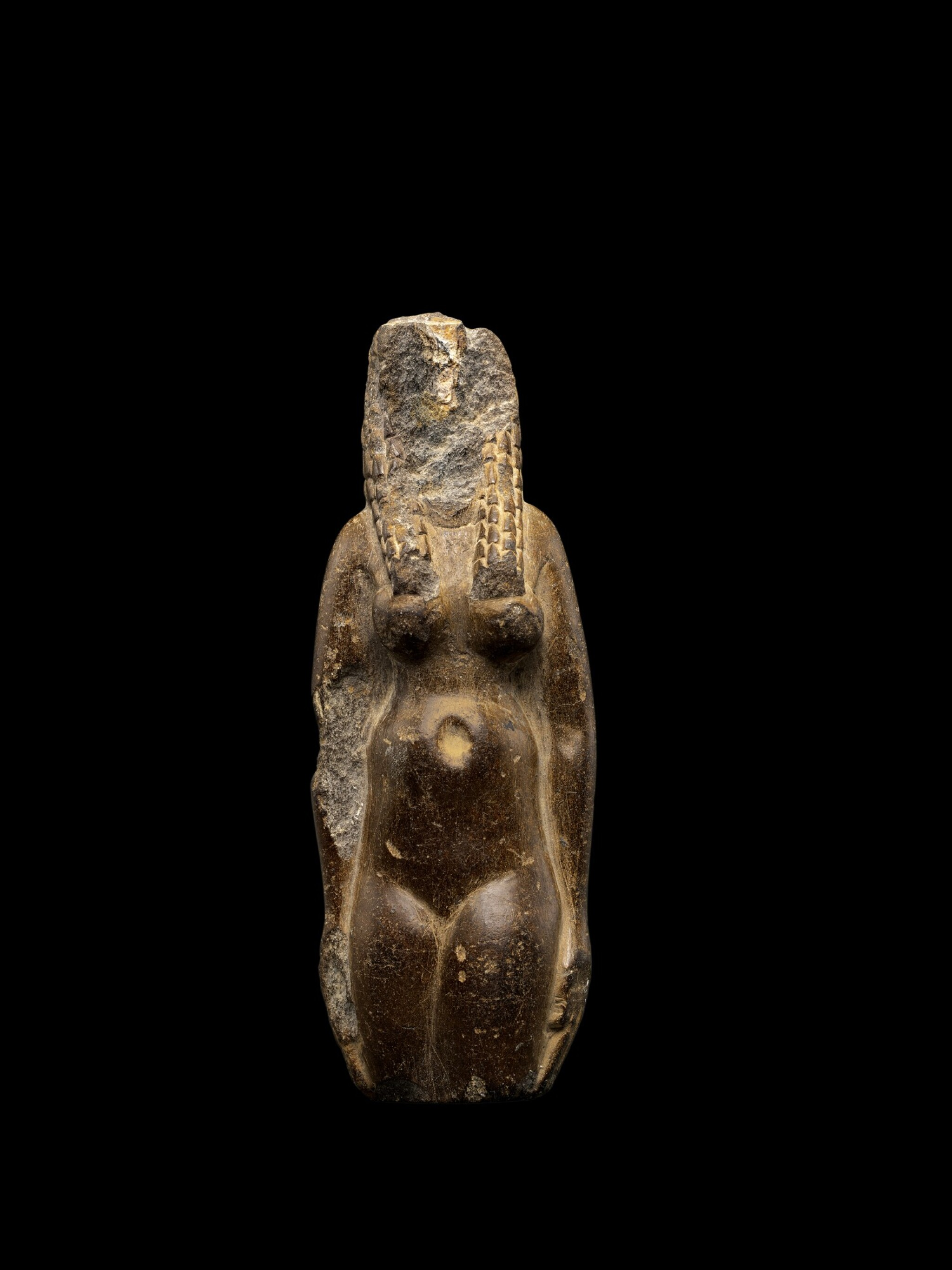 View 1 of Lot 50. An Egyptian Fragmentary Brown Steatite Figure of Hathor, Ptolemaic Period, 305-30 B.C..