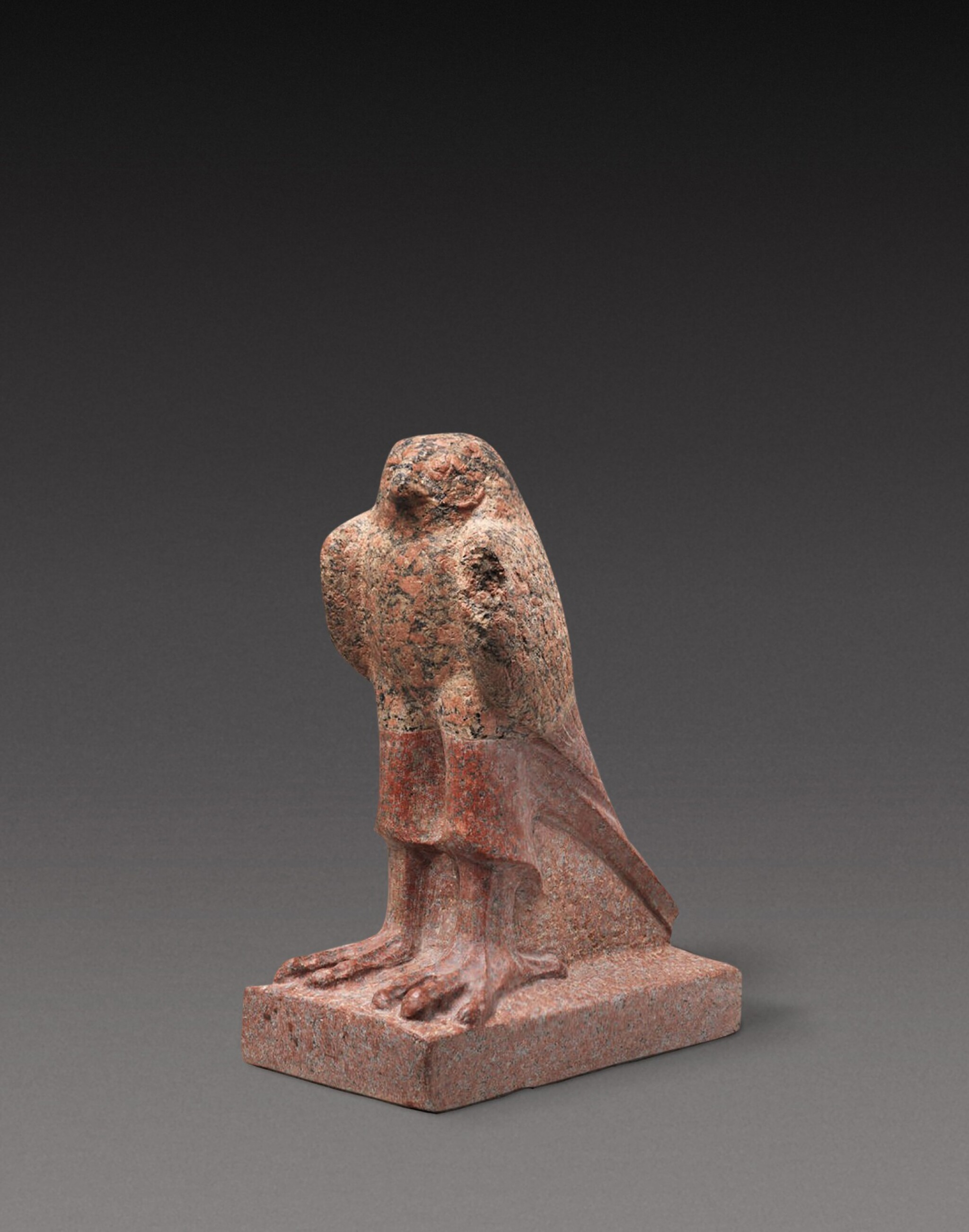 View 1 of Lot 39. A Fragmentary Egyptian Red Granite Figure of the Horus Falcon, Ptolemaic Period, 305-30 B.C..