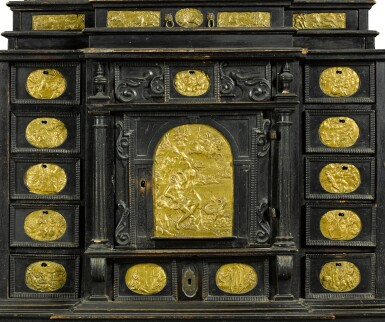 View 4. Thumbnail of Lot 86. A South German gilt-metal mounted, ebonised and carved table cabinet, possibly Augsburg, early 17th century.