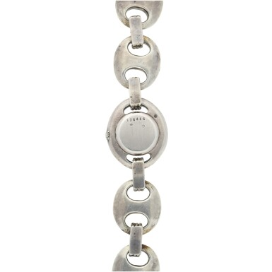 View 5. Thumbnail of Lot 238. RETAILED BY HERMES: A LADY'S STERLING SILVER BRACELET WATCH, CIRCA 1955.