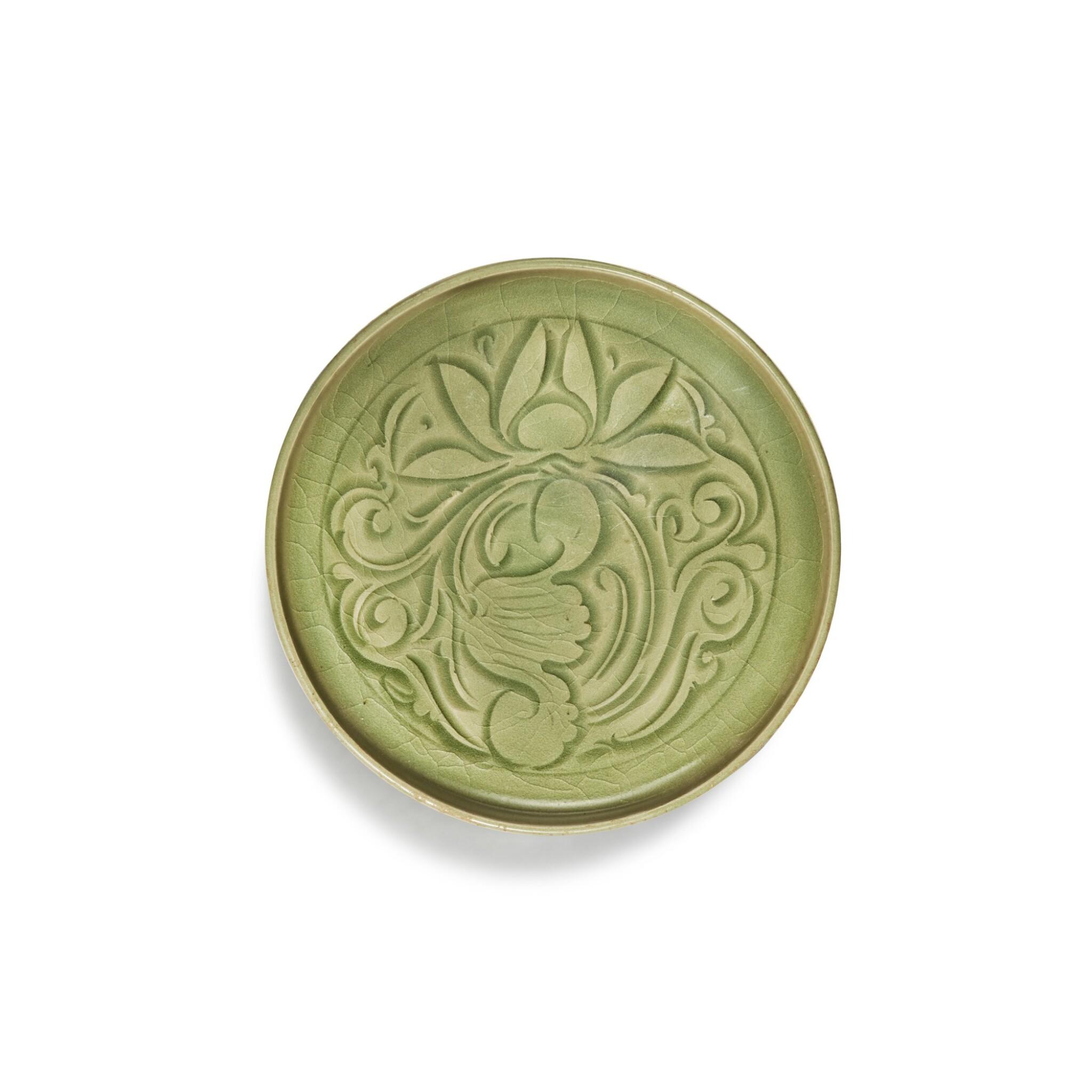 View full screen - View 1 of Lot 95. A carved 'Yaozhou' celadon-glazed dish, Northern Song / Jin dynasty   北宋 / 金 耀州窰青釉刻蓮紋盤.