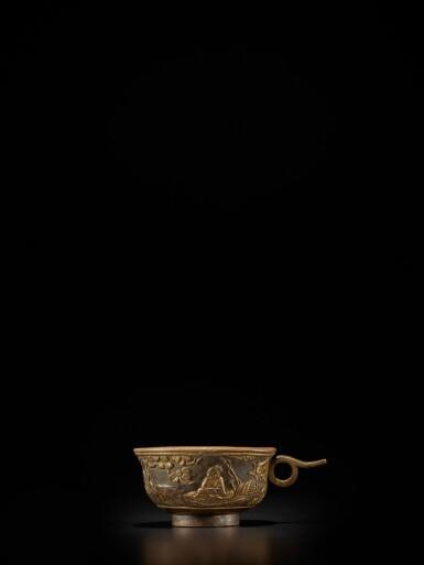 View 1. Thumbnail of Lot 124. A small parcel-gilt-bronze cup, Ming dynasty, Wanli period, dated renzi year, corresponding to 1612 | 明萬曆壬子年(1612年) 銅局部鎏金松下高士圖小盃 《萬曆壬子》款.