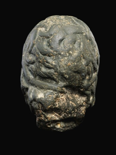 View 4. Thumbnail of Lot 26. A ROMAN GRAYWACKE HEAD OF A YOUTH, CIRCA 2ND CENTURY A.D..
