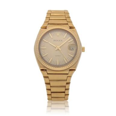 View 1. Thumbnail of Lot 428. 'The Texan' Quartz, Ref. 5100 BETA 21 Yellow gold wristwatch with date and bracelet Circa 1970   勞力士 5100 BETA 21型號「'The Texan' Quartz」黃金鍊帶腕錶備日期顯示,年份約1970.