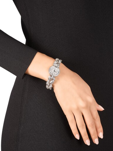 View 4. Thumbnail of Lot 1057. 'Graff Leaf' Reference GL25WGDDDD, Limited Edition White Gold and Diamond-Set Wristwatch, Number 1   格拉夫  Graff Leaf編號GL25WGDDDD,限量版白金鑲鑽石腕表,編號1,約2010年製.