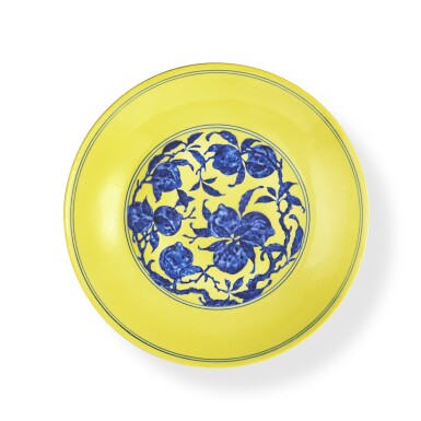 View 1. Thumbnail of Lot 72. A yellow-ground underglaze-blue 'nine peaches' dish, Seal mark and period of Qianlong   清乾隆 黃地青花九桃紋盤 《大清乾隆年製》款.