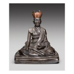 A SILVER FIGURE OF THE FIFTH SHARMAPA, KONCHOK YANGLAK,  TIBET, 17TH CENTURY