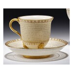 A ROYAL WORCESTER RETICULATED PORCELAIN DOUBLE-WALLED CABINET CUP AND STAND BY GEORGE OWEN 1924