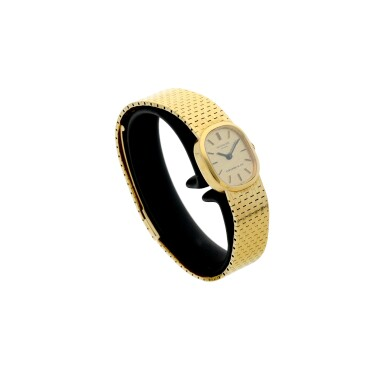 View 3. Thumbnail of Lot 147. PATEK PHILIPPE   REFERENCE 4106  RETAILED BY TIFFANY & CO.: A YELLOW GOLD BRACELET WATCH, MADE IN 1974.