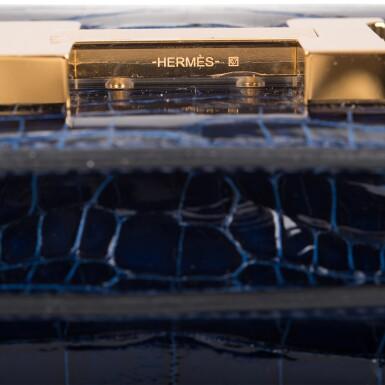 View 6. Thumbnail of Lot 3. Hermès Bleu Saphir Constance 18cm of Shiny Alligator with Gold Hardware.
