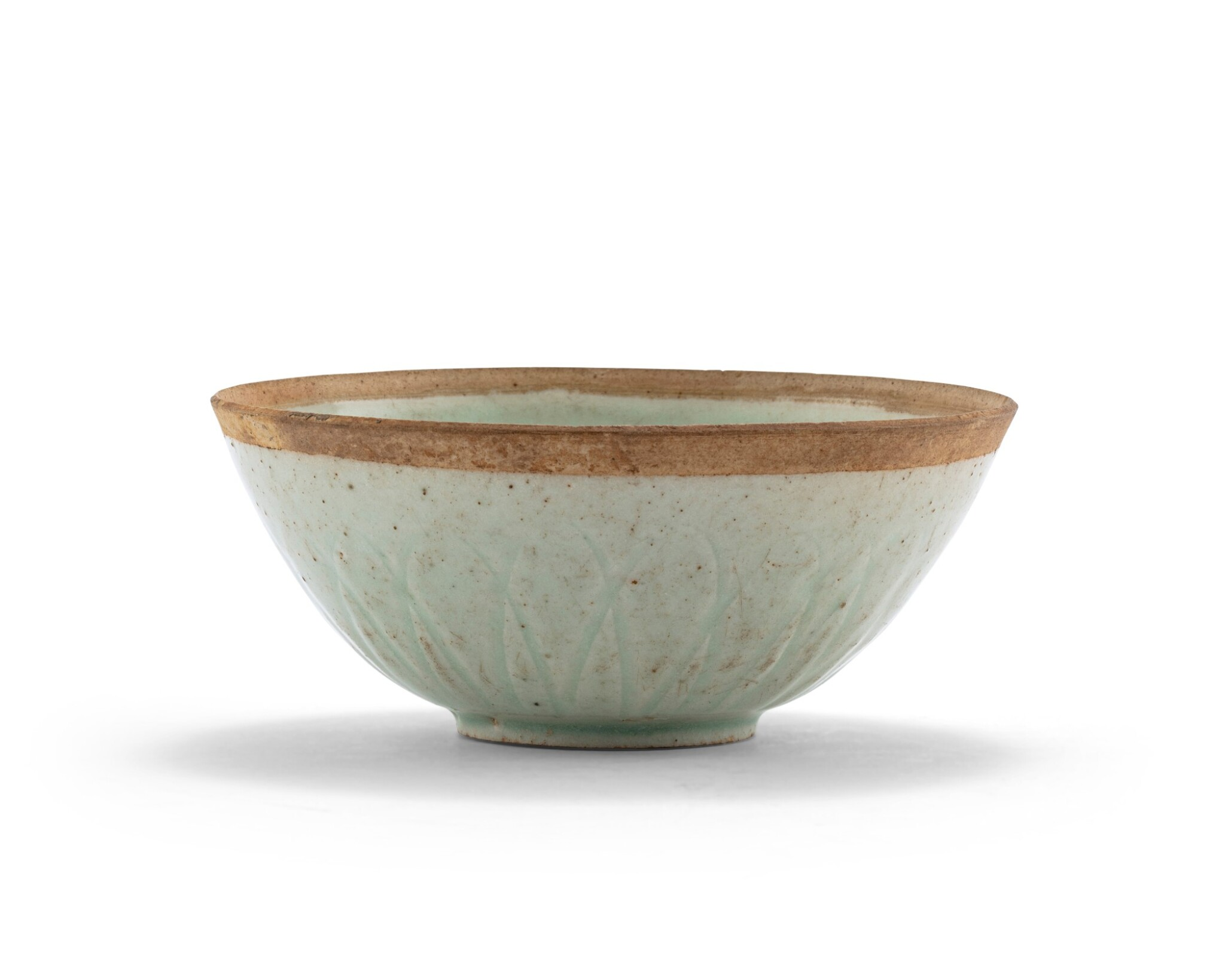 View 1 of Lot 5. Bol 'lotus' à glaçure qingbai Dynastie des Song du Sud | 南宋 青白釉蓮瓣盌 | A qingbai 'lotus' bowl, Southern Song Dynasty.