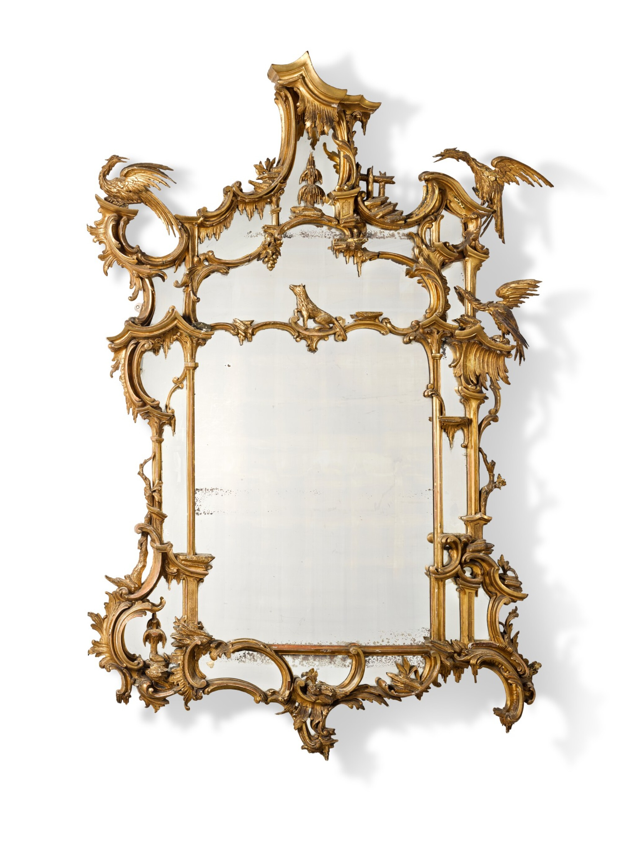View full screen - View 1 of Lot 164. A late George II carved giltwood wall mirror, after a design by Thomas Johnson, circa 1760.