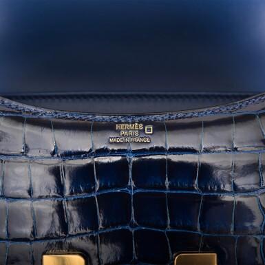 View 8. Thumbnail of Lot 3. Hermès Bleu Saphir Constance 18cm of Shiny Alligator with Gold Hardware.