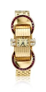RUBY AND DIAMOND BRACELET-WATCH, 'SHUTTER', VAN CLEEF & ARPELS   紅寶石 配 鑽石 腕錶, 'Shutter', 梵克雅寶(Van Cleef & Arpels)