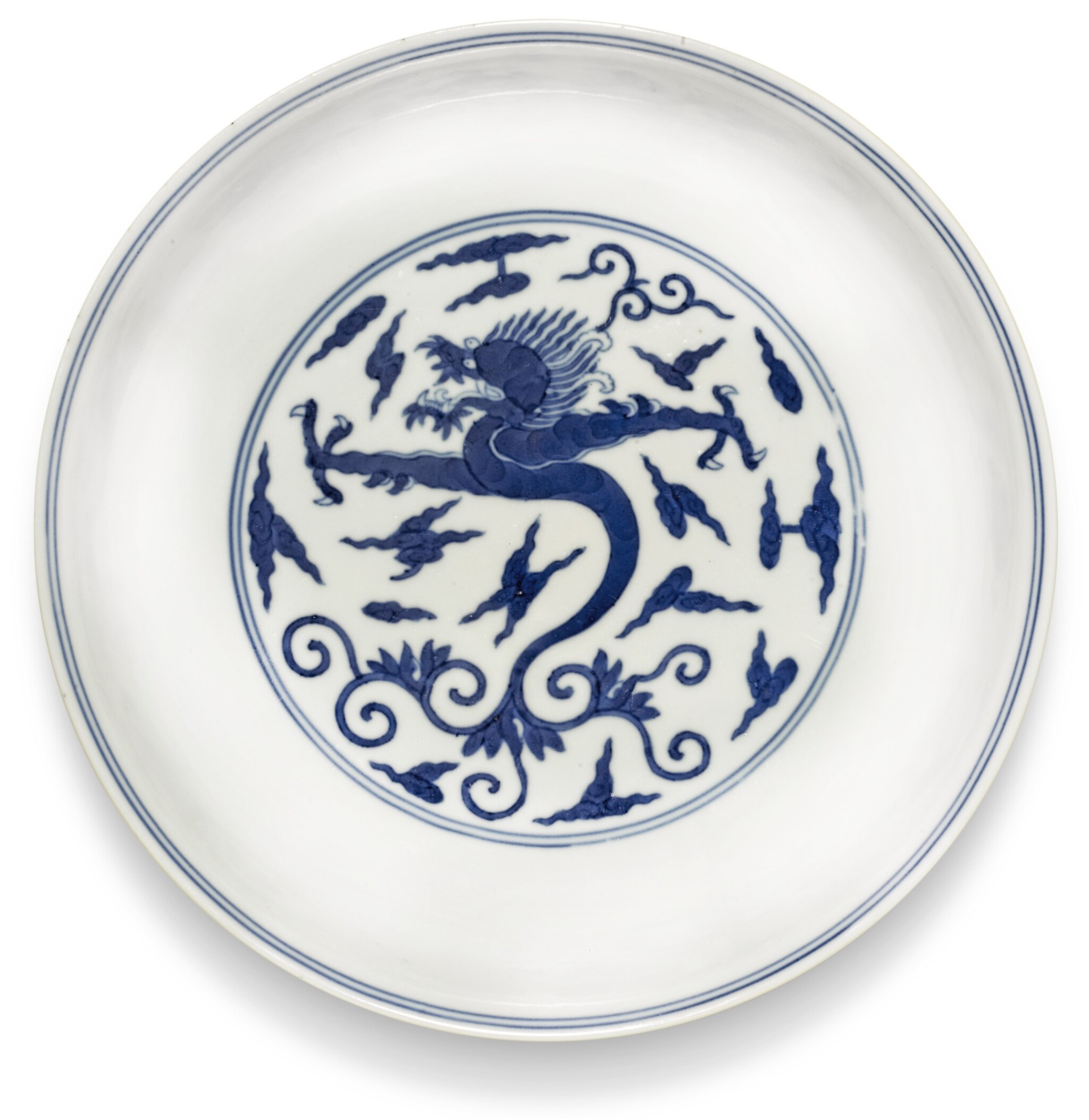View 1 of Lot 160. A BLUE AND WHITE MING-STYLE 'DRAGON' DISH JIAQING SEAL MARK AND PERIOD | 清嘉慶 青花卷草雲龍紋盤 《大清嘉慶年製》款.