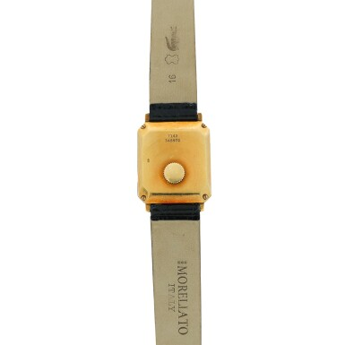 View 5. Thumbnail of Lot 138. Reference 7142 A yellow gold rectangular shaped wristwatch with ridged bezel, Circa 1975.