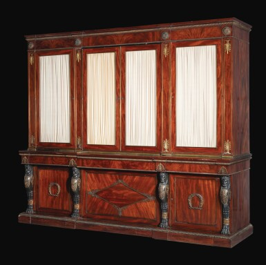 View 1. Thumbnail of Lot 28. A late George III gilt-bronze mounted mahogany library bookcase incorporating a concealed door, circa 1805-10, attributed to Marsh and Tatham after designs by Thomas Hope.