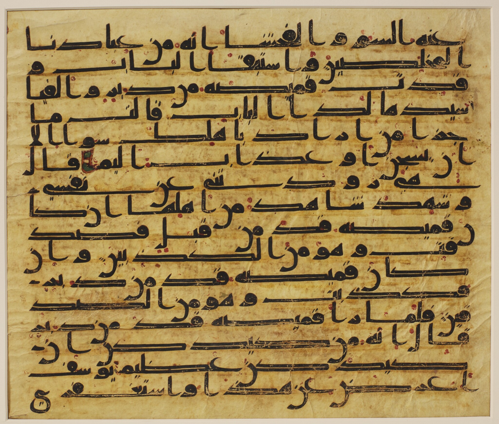 View full screen - View 1 of Lot 1. A LARGE QUR'AN LEAF IN KUFIC SCRIPT ON VELLUM, NORTH AFRICA OR NEAR EAST, CIRCA 750-800 AD.